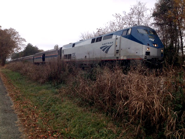 Amtrak train derails, dangles over interstate in Washington state