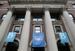 FILE - In this May 28, 2015 file photo, banners hang from a building at Barnard College in New York. Barnard College has decided to admit transgender women, becoming the latest women's college to issue a new policy acknowledging the fluidity and complexity of gender. (AP Photo/Seth Wenig, File)