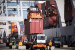 FILE- In this Oct. 8, 2014, file photo, ship to shore cranes load shipping containers onto jockey trucks from a cargo ship at the Port of Savannah in Savannah, Ga. The Commerce Department reports on the U.S. trade gap for April 2015 on Wednesday, June 3, 2015. (AP Photo/Stephen B. Morton, File)