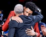 Jahlil Okafor hugs friends and family after being selected third overall by the Philadelphia 76ers during the NBA basketball draft, Thursday, June 25, 2015, in New York. (AP Photo/Kathy Willens)