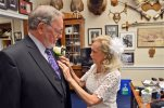 In this image provided by Rep. Don Young's Press Secretary Matthew Shuckerow, Anne Garland Walton, right, pins a flower on the lapel of Young just before they got married in his office in Juneau, Alaska, Tuesday, June 9, 2015. Young, the longest-serving Republican in the U.S. House married Walton during a private ceremony Tuesday in the chapel of the U.S. Capitol. (Matthew Shuckerow/Congressman Don Young's Office via AP)