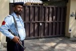 "A Pakistani police officer stands guard outside a sealed office of international aid group Save the Children , in Islamabad, Pakistan, Sunday, June 14, 2015. Pakistan's Interior Ministry has halted an order it made closing the office of Save the Children in Islamabad, an official said Sunday. On Thursday, Pakistan shuttered the group's main office in the capital for allegedly ""violating its charter.""  (AP Photo/Anjum Naveed)"