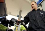FILE - In this May 6, 2015 file photo, attendant James Lewis pumps gas at a station in Portland, Ore. The average price of regular gasoline in the U.S. jumped 3 cents a gallon in the past two weeks to $2.87 a gallon. (AP Photo/Don Ryan, File)