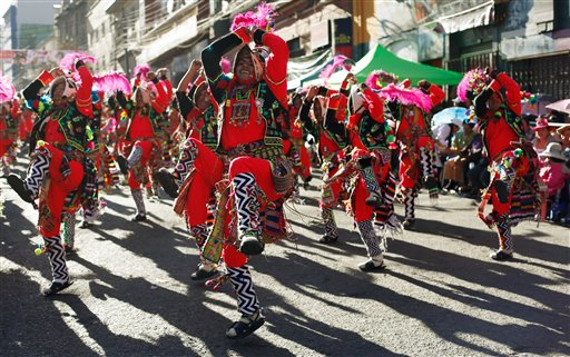 "In this May 30, 2015 photo, revelers of the Los Tinkus dance troupe perform during the annual parade in honor of ""El Senor del Gran Poder,"" or ""The Lord of Great Power"" in La Paz, Bolivia. The weeklong celebration is the city's largest festival and a major showcase of Andean folklore. (AP Photo/Juan Karita)"