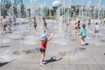 Children play in the fountains at Andre Citroen square in Paris, France, Tuesday, June 30, 2015. A mass of hot air moving north from Africa is bringing unusually hot weather to Western Europe, with France the next in line for a scorching day. (AP Photo/Kamil Zihnioglu)