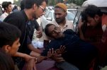 People rush a man to a hospital as he suffers from a heatstroke in Karachi, Pakistan, Tuesday, June 23, 2015. A scorching heat wave across the southern city has killed hundreds of people, authorities said Tuesday. The heat wave compounded the struggles of ordinary Pakistanis as it struck amid the holy, fasting month of Ramadan, when observant Muslims abstain from food or water during daylight hours. (AP Photo/Shakil Adil)