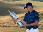 Jordan Spieth looks at the trophy after winning the final round of the U.S. Open golf tournament at Chambers Bay on Sunday, June 21, 2015 in University Place, Wash. (AP Photo/Matt York)