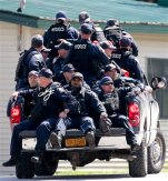 Corrections officers rush to an area of a possible sighting of two escaped prisoners from Clinton Correctional Facility in Dannemora, on Tuesday, June 23, 2015, in Mountain View, N.Y. Police began focusing intensely on an area 20 miles west of the prison that inmates David Sweat and Richard Matt escaped from prison on June 6. (AP Photo/Mike Groll)