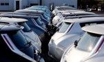 FILE - In this Feb. 5, 2015 file photo, Nissan electric vehicles sit on display at an auto dealership in Roswell, Ga. Nissan's April-June profit jumped 36 percent as the Japanese automaker benefited from a cheap yen and better sales in the U.S. and Europe. Nissan Motor Co., which makes the March subcompact, Leaf electric car and Infiniti luxury models, reported Wednesday, July 29, a fiscal first quarter profit of 152.8 billion yen ($1.2 billion). (AP Photo/David Goldman, File)