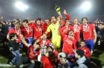 Chile's players celebrate with the Copa America trophy after defeating Argentina in the final soccer match at the National Stadium in Santiago, Chile, Saturday, July 4, 2015. Chile became Copa America champions for the first time after defeating Argentina in a penalty shootout. (AP Photo/Luis Hidalgo)