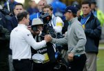United States' Zach Johnson, left, is congratulated by United States' Jordan Spieth after winning a playoff after the final round of the British Open Golf Championship at the Old Course, St. Andrews, Scotland, Monday, July 20, 2015. (AP Photo/David J. Phillip)