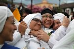 Nuns embrace at Independence square, while they wait for the Pope's arrival to the government palace in Quito, Ecuador, Monday, July 6, 2015. Pope Francis is making his first visit to his Spanish-speaking neighborhood. He travels to three South American nations, Ecuador, Bolivia and Paraguay. (AP Photo/Ana Buitron)