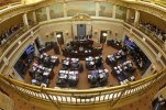 FILE - This Feb. 24, 2015, file photo, shows the Senate floor at the Utah State Capitol, in Salt Lake City. More than 50 new laws are set take effect in Utah on Wednesday, July 1, 2015, including measures requiring high school students to pass a U.S. citizenship test, restricting electronic cigarette sellers and expanding death benefits for the families of fallen police officers and firefighters. (AP Photo/Rick Bowmer, File)