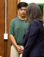 Adrian Jerry Gonzalez, 15, enters the courtroom Thursday, July 30, 2015 where his arraignment was delayed in Santa Cruz, Calif.  Gonzalez is charged with murder, kidnapping and rape in the death of 8-year-old Madyson Middleton, in an artists' complex in the California beach town. (Dan Coyro/Santa Cruz Sentinel via AP)   MANDATORY CREDIT