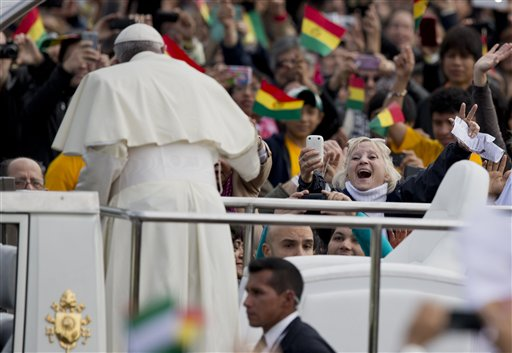 Faithful cheer as Pope Francis arrives to celebrate Mass at Christ the Redeemer square in Santa Cruz, Bolivia, Thursday, July 9, 2015. After the Mass, Francis' main event of the day is a keynote speech to a summit of grass-roots groups whose advocacy for the poor and marginalized has been championed by history's first Latin American pope. (AP Photo/Eduardo Verdugo)