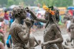 Caprise Debose, left, and Kaliyah Watson, of Westland, play together during the annual Mud Day at Nankin Mills Park in Westland, Mich. on Tuesday, July 7, 2015. (David Guralnick/The Detroit News via AP) DETROIT FREE PRESS OUT - HUFFINGTON POST OUT - NO MAGS - NO SALES- NO ARCHIVE - MANDATORY CREDIT