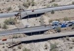 This aerial photo shows the collapsed elevated section of Interstate 10, Monday, July 20, 2015, in Desert Center, Calif. All traffic along one of the major highways connecting California and Arizona was blocked indefinitely when the bridge over a desert wash collapsed during a major storm, and the roadway in the opposite direction sustained severe damage. (AP Photo/Matt York)