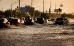 Cars drive through flood water on a street Monday, July 6, 2015, in Las Vegas. Heavy rain throughout the area prompted the National Weather Service to issue a flash flood warning for parts of Las Vegas. (AP Photo/John Locher)