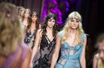Kendall Jenner , centre, wears a creation for Italian fashion designer Donatella Versace's fall-winter 2015/2016 Haute Couture fashion collection presented in Paris, France, Sunday, July 5, 2015. (AP Photo/Kamil Zihnioglu)