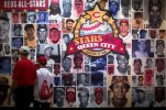 "Visitors browse the ""Stars of the Queen City"" exhibit at the Cincinnati Reds Hall of Fame and Museum, Friday, July 3, 2015, in Cincinnati. Adjacent to the Great American Ball Park, where the July 14 All-Star Game will be played, the Reds' own Hall of Fame and Museum is filled with artifacts and interactive exhibits covering Cincinnati players from the Wrights to the ""Big Red Machine"" of the 1970s to the current team. (AP Photo/John Minchillo)"