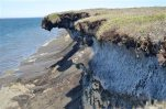This July 6, 2011 photo, provided by the U.S. Geological Survey shows erosion along the northern Alaska coast in Barter Island, Alaska. Erosion is eating away at Alaska's northern coast at some of the highest rates in the nation, threatening habitat and infrastructure, according to a new report published Wednesday, July 1, 2015. (Ben Jones/U.S. Geological Survey via AP)
