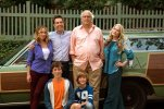 """In this image released by Warner Bros. Entertainment, Christina Applegate, standing from left, Ed Helms, Chevy Chase, Beverly D'Angelo, and Skyler Gisondo, kneeling left, and Steele Stebbins appear in a scene from """"Vacation."""" In Hollywood's reboot frenzy, the movie industry has increasingly turned to reviving classic comedies. The latest attempt is """"Vacation,"""" a new try at the 1983 classic National Lampoon film starring Chase. He makes a cameo in the latest """"Vacation,"""" returning as Clark Griswold, but has ceded the driver's seat to his son, Rusty Griswold, played by Helms. (Hopper Stone/Warner Bros. Entertainment via AP)"""
