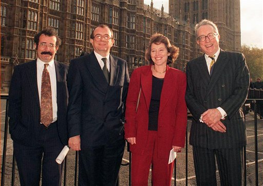 "In this Jan. 22, 2001 file photo, John Sewel, second left, poses with his fellow new Labour peers, from left, Robert Winston, Helene Hayman and Gordon Johnson Borrie, at Westminster, in London. A member of the House of Lords has resigned from the chamber and apologized after he was filmed in an alleged cocaine-and-sex session with prostitutes. John Sewel caved in to pressure on Tuesday, July 28, 2015 telling parliamentary officials in a statement that he was ""terminating my membership of the House of Lords.'' He now says he can best serve the house by leaving it. (Michael Stephens, PA via AP) UNITED KINGDOM OUT NO SALES NO ARCHIVE"