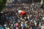 FILE - In this Thursday, July 2, 2015, file photo, people carry the coffin for 1st Lt. Mohammed Ashraf, killed in Wednesday's attack by Islamic militants in the Sinai, during the funeral procession in Ashmoun, north of Cairo, Egypt. When Abdel-Fattah el-Sissi  led the army's overthrow of Egypt's Islamist president two years ago, he promised to usher in new stability for the country. Instead, now President el-Sissi is facing an even tougher challenge: An Islamic militant insurgency that unleashed its worst violence yet the past week. (AP Photo/Ashour Abosalm, File)