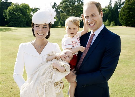 This is a handout image released by Kensington Palace on Thursday July 9, 2015. shows Britain's Prince William, and Kate Duchess of Cambridge as they hold their children, Prince George, 2nd right, and Princess Charlotte in the grounds of Sandingham House in England after the christening of the princess on Sunday July 5, 2015.  (Mario Testino/Art Partner/Kensington Palace via AP) MANDATORY CREDIT EDITORIAL USE ONLY NO NO SALES NO COMMERCIAL USE  ONE TIME USE ONLY