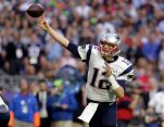 FILE - In this Feb. 1, 2015, file photo, New England Patriots quarterback Tom Brady (12) throws a pass during the first half of the NFL Super Bowl XLIX football game against the Seattle Seahawks in Glendale, Ariz. (AP Photo/Patrick Semansky)