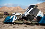 FILE - In this Nov. 1, 2014 file photo, wreckage lies near the site where a Virgin Galactic space tourism rocket, SpaceShipTwo, exploded and crashed in Mojave, Calif. The National Transportation Safety Board (NTSB) will meet July 28 to determine what likely caused a Virgin Galactic spaceship to break apart over the Mojave Desert during a test flight 10 months ago, killing the co-pilot and seriously injuring the pilot. (AP Photo/Ringo H.W. Chiu, File)