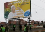 """Police stand guard near a billboard of Pope Francis covered by the Spanish words: """"With Francis. We announce the joy of the Gospel"""" as they train ahead of his arrival in El Alto, Bolivia, Saturday, July 4, 2015. The pope's trip to South America that includes Bolivia is set for July 5-12, though he will only spend four hours in Bolivia due to the altitude, church officials say. (AP Photo/Juan Karita)"""