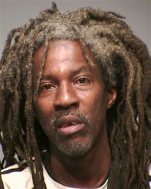 This undated booking photograph released Monday, July 27, 2015, by the New Haven Police Department shows Ray Roberson. New Haven police said Monday that DNA testing showed that the severed legs found on July 15 near a train station were those of 54-year-old Roberson. He was last seen on May 20 but wasn't reported missing. (New Haven Police Department via AP)