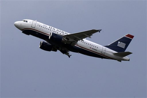 FILE - In this July 23, 2013, file photo, a US Airways jet takes off from Pittsburgh International Airport in Imperial, Pa. The last flight for US Airways will take place in fall 2015, and then one more name in airline history will disappear. American and US Airways merged in December 2013 and decided to keep the better-known American name. (AP Photo/Gene J. Puskar, File)