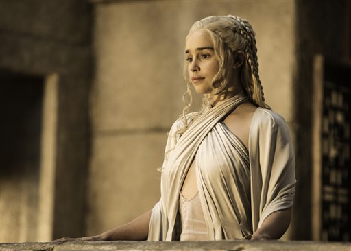 "In this image released by HBO, Emilia Clarke appears in a scene from ""Game of Thrones. Clarke was nominated for an Emmy Award on Thursday, July 16, 2015, for outstanding supporting actress in a drama series for her role on the show. The 67th Annual Primetime Emmy Awards will take place on Sept. 20, 2015.  (Helen Sloane/HBO via AP)"