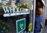 FILE - In this June 24, 2015, file photo, a shopper leaves the Whole Foods Market store in New York's Union Square. Whole Foods reports quarterly financial results on Wednesday, July 29, 2015. (AP Photo/Julie Jacobson, File)