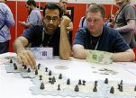 Zohar Bhagat, left, and John Grudzina, of New York, play a game of Samurai in the exhibition hall at the Gen Con gaming convention in Indianapolis, Thursday, July 30, 2015. Adrian Swartout, the CEO of the gaming convention Gen Con said says Indiana should pass broader civil rights protections for the lesbian-gay-bisexual-transgender community.  Her call comes after a national outcry over Indiana's new religious objections law, which critics decried as anti-LGBT until a legislative fix was approved. (AP Photo/Michael Conroy)