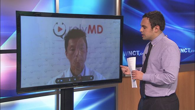 WNCT reporter Brandon Goldner and Dr. Bobby Park demonstrate how a video chat doctor's appointment would generally look.
