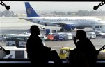 FILE - In this Monday, April 21, 2008 file photo, tourists wait for their flight, as an Egyptair plane is seen, background, at a waiting hall in Cairo's international airport in Egypt. Egypt's civil aviation minister says he is replacing EgyptAir's chairman in a bid to return the company to profitability, after it accumulated over a billion dollars in losses since the 2011 uprising that toppled longtime autocrat Hosni Mubarak. (AP Photo/Amr Nabil, File)