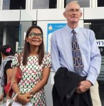 In this July 14, 2015, file photo, Alan Morison, right, Australian editor of the website Phuketwan, and his colleague Chutima Sidasathien speak to reporters ahead of their appearance in court to face charges of violating Thailand's Computer Crime Act in Phuket, Thailand. Morison and Chutima on Tuesday, Sept. 1, 2015, have been cleared of charges of defaming the Thai navy by a court on the island of Phuket. (AP Photo/Thanyarat Doksone, File)