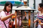 In this Aug. 26, 2015, file photo, worshippers light sticks of incense at the Erawan Shrine at Rajprasong intersection, in Bangkok, Thailand. Thai police probing Bangkok's deadly bombing said on Monday, Aug. 31, 2015, that they have discovered bomb-making materials during a raid of a second apartment on the outskirts of the capital. (AP Photo/Penny Yi Wang, File)