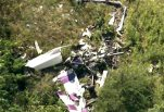 This image taken from video and provided by WABC/abc7NY.com, shows the wreckage of a stunt plane from the air of WABC TV's NewsCopter7 as it flies near Stuart Air Force Base in New Windsor, N.Y., Friday, Aug. 28, 2015. A pilot was killed after his propeller-driven stunt plane crashed while he was practicing tricks for a weekend air show in New York's Hudson Valley, state police said Friday. (WABC/abc7NY.com via AP)