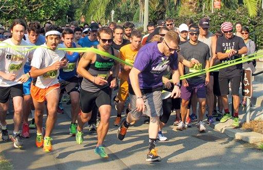 Runners take off in a 4.2-mile run, part of the 420 Games, an effort to stop the stigmatization of cannabis use through athletic events, at Golden Gate Park in San Francisco Saturday, Aug. 15, 2015. Students, accountants, businessmen, housewives and many others in green T-shirts and all wearing the number 420 raced to change the stereotypical images of marijuana smokers as lazy and lethargic stoners who binge on junk food.(AP Photo/Olga Rodriguez)