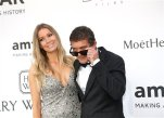 In this May 21, 2015 file photo, Nicole Kimpel and Antonio Banderas pose for photographers upon arrival for the amfAR Cinema Against AIDS benefit during the 68th Cannes international film festival in Cap d'Antibes, southern France. In an interview with Vanity Fair, the first after her romance with Banderas was made public in 2014, Kimpel said that the Spanish actor still has ties with his ex, Melanie Griffith. (AP Photo/Thibault Camus, File)