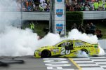 Matt Kenseth smokes his tires after winning the NASCAR Pocono 400 auto race, Sunday, Aug. 2, 2015, in Long Pond, Pa. (AP Photo/Matt Slocum)