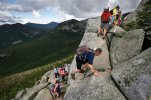 In this Saturday, Aug. 7, 2015 photo, day-hikers scramble over rocky boulders on the Appalachian Trail below the summit of Mt. Katahdin in Baxter State Park in Maine. The sharp rise in the number people using the Appalachian Trail is causing headaches for officials, who say they're dealing with increasing problems along the 2,189-mile footpath. (AP Photo/Robert F. Bukaty)