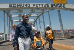 "Cornell William Brooks, NAACP president, holds the hand of Rachel Quarterman, 7, while leading the ""America's Journey for Justice March"" organized by the NAACP on Saturday, Aug. 1, 2015, in Selma, Ala. The 860 mile relay march is planned to go from Selma to Washington D.C. over the course of 40 days. (Albert Cesare/Montgomery Advertiser via AP)"