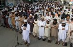"Supporters of a Pakistani religious group, ""Jamaat-ud-Dawa,"" offer funeral prayers for Taliban leader Mullah Mohammad Omar outside a mosque in Karachi, Pakistan, Sunday, Aug. 2, 2015. Afghanistan's Taliban on Thursday confirmed the death of Mullah Omar, who led the group's self-styled Islamic emirate in the 1990s, sheltered al-Qaida through the 9/11 attacks and led a 14-year insurgency against U.S. and NATO troops. (AP Photo/Fareed Khan)"