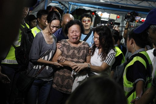 Relatives of Lim Saw Gaik, 49 and son, Neoh Jai Jun, 20, victims of Monday's bombing at a popular Bangkok shrine arrive to pay their final respects at the Neoh's home in Penang, Malaysia, Thursday, Aug. 20, 2015. Monday's bombing at the Erawan Shrine, which authorities have called the worst in Thai history, killed 20 people and wounded 120 others. (AP Photo/Joshua Paul)