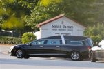 A hearse arrives at St. James United Methodist Church before funeral services for Bobbi Kristina Brown Saturday, Aug. 1, 2015, in Alpharetta, Ga. Brown, the only child of Whitney Houston and R&B singer Bobby Brown, died in hospice care July 26, about six months after she was found face-down and unresponsive in a bathtub in her suburban Atlanta townhome.  (AP Photo/John Bazemore)